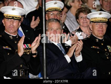 U.S. President George W. Bush (C) applauds with Gen. James Conway, Commandant of the Marine Corps, and Col. Andrew H. Smith (L), Commanding Officer of the Marine Barracks of Washington, during an Evening Parade at the Marine Barracks in Washington August 29, 2008. REUTERS/Yuri Gripas  (UNITED STATES) - Stock Photo