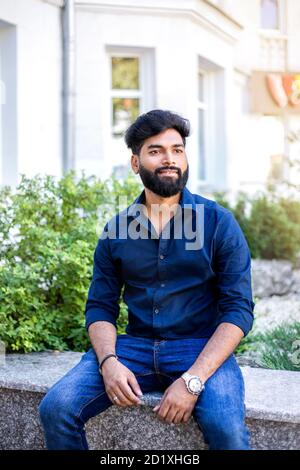 Fashion business man in shirt posing in the street. - Stock Photo