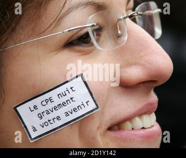 A French student sticks sign on face which reads 'CPE is harmful to future' in protest against the government's new plan for reducing joblessness, in Lille, northern France March 16, 2006. The new job contract, known as the CPE, would allow firms to hire youths under 26 for a two-year trial period before offering them a permanent job. - Stock Photo