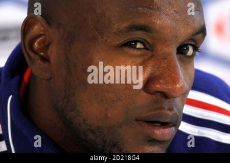 France's national soccer team player Eric Abidal attends a news conference in Knysna, near Cape Town June 13, 2010. REUTERS/Charles Platiau (SOUTH AFRICA - Tags: SPORT SOCCER WORLD CUP HEADSHOT)