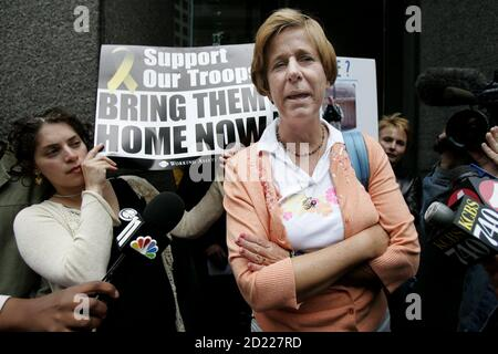 Iraq war protester Cindy Sheehan (R) speaks to the media outside the office of Senator Dianne Feinstein in San Francisco, California, September 9, 2005. Sheehan, who says her focus now will be Congress, met with staff of Senator Feinstein to discuss the war in Iraq. REUTERS/Kimberly White  KW - Stock Photo