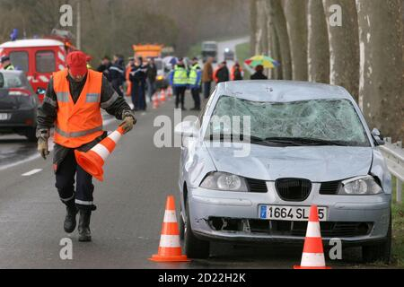 Emergency services gather at the scene of an accident where a car hit a group of 10 cyclists in Villecomtal sur Arros in southwestern France, March 8, 2009. At least one cyclist was killed and the others injured in the accident.    REUTERS/Laurent Dard  (FRANCE DISASTER) - Stock Photo