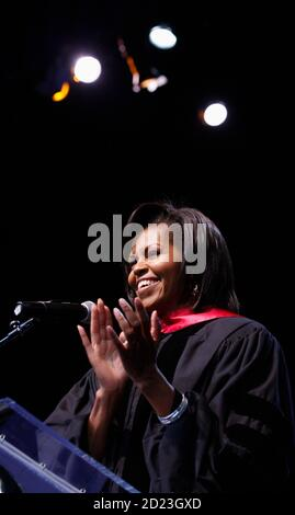 U.S. first lady Michelle Obama gives the commencement address at the graduation ceremony for the Washington Mathematics Science Technology Public Charter High School in Washington June 3, 2009.      REUTERS/Jason Reed        (UNITED STATES EDUCATION POLITICS) - Stock Photo