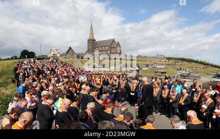 Members of the Orange Order hold their annual protest outside Drumcree Church, as they are prohibited from walking back to their Lodge headquarters along the Nationalist Garvaghy Road, in Portadown July 4, 2010. The Orange Order has been banned from going down this road since 1998, due to violent confrontations that had previously occurred between the marchers and the Nationalists. REUTERS/Cathal McNaughton (NOR RN IRELAND - Tags: CIVIL UNREST RELIGION IMAGES OF THE DAY) - Stock Photo