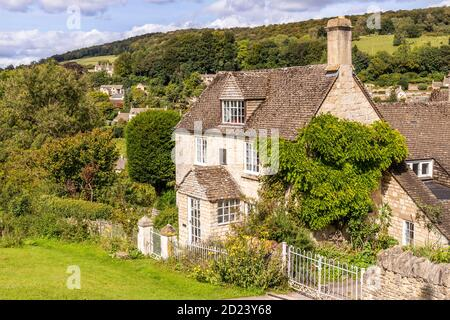 A stone cottage in the Cotswold village of Sheepscombe, Gloucestershire UK