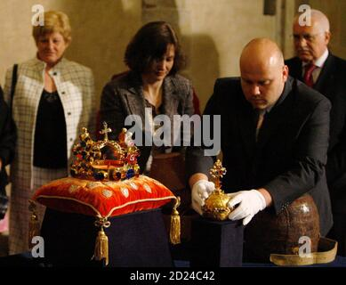 Czech President Vaclav Klaus (R) watches a curator adjust a Royal Apple next to the Crown of Saint Wenceslas of Bohemia as the Crown jewels of the Czech Kings were removed from St.Vitus cathedral in the Prague Castle April 17, 2008. The unusually designed crown was made from gold and precious stones for King Charles IV in 1346. The Czech jewels and the Crown of Saint Wenceslas are displayed to the public only once every five years.    REUTERS/Petr Josek  (CZECH REPUBLIC) - Stock Photo