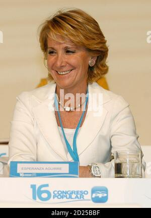 Madrid's regional president Esperanza Aguirre smiles during the opening session of the Popular Party's 16th National Congress in Valencia June 20, 2008. REUTERS/Heino Kalis (SPAIN)