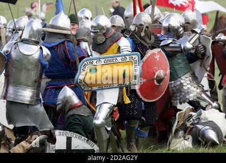 Amateur actors fight during a re-enactment of the battle at Grunwald, which took place 1410 between Teutonic order knights and Polish and Lithuanian knights, in Grunwald, north Poland July 15, 2006. REUTERS/Katarina Stoltz (POLAND) - Stock Photo