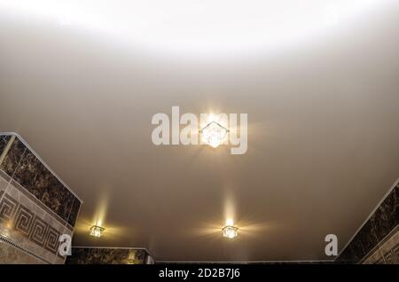 Stretch ceiling in the bathroom with three spotlights