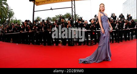 Actress and model Devon Edwenna Aoki poses on the red carpet as she arrives for the screening of the film 'Chun feng chen zui de ye wan' (Spring Fever) by director Lou Ye at the 62nd Cannes Film Festival May 14, 2009. Twenty films compete for the prestigious Palme d'Or which will be awarded on May 24.  REUTERS/Eric Gaillard  (FRANCE ENTERTAINMENT IMAGES OF THE DAY) FOR BEST QUALITY IMAGE ALSO SEE: GM1E99K1QRG01
