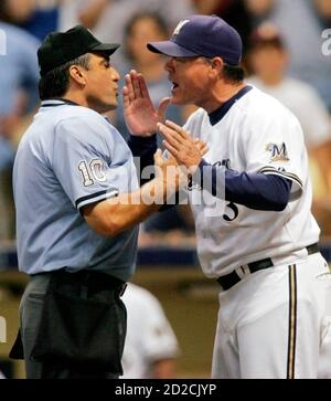 Milwaukee Brewers manager Ned Yost (3) continues to argue after being ejected from the ballgame by home plate umpire Phil Cuzzi (L) after St. Louis Cardinals baserunner Rick Ankiel scored on a close play at home plate in the seventh inning of a National League MLB baseball game in Milwaukee, Wisconsin September 24, 2007.         REUTERS/Allen Fredrickson  (UNITED STATES)
