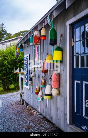 boat house decorated with antique wooden lobster buoys - Stock Photo