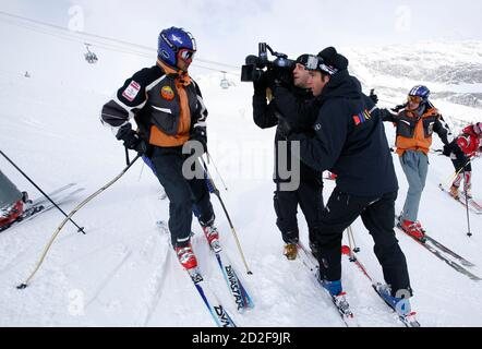 Shyam Dhakal (L), of the Nepal ski team, answers questions from French reporters during a training session at the Alpine Skiing World Championships 2009 in the French resort of Val d'Isere February 11, 2009.     REUTERS/Denis Balibouse (FRANCE) - Stock Photo