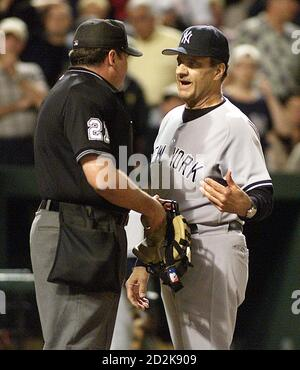 New York Yankees manager Joe Torre (R) briefly argues in vain with home plate umpire Hunter Wendelstedt after Wendelstedt called Yankees base runner Bernie Williams out on a close play at home plate in the seventh inning of their game against the Baltimore Orioles at Camden Yards in Baltimore, Maryland September 28, 2005. The Yankees went on to win the game 2-1. REUTERS/Joe Giza