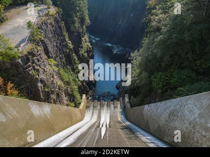 Cleveland Dam by Capilano Lake in North Vancouver, BC. The aerial view on dam and surrounding rocky cliffs.