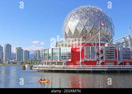 Main Street Science World in Vancouver, BC. Small cayak in the foreground. Sunny summer day in Olympic village.