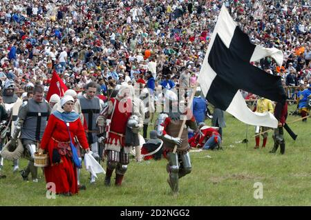 Amateur actors prepare before a re-enactment of the battle at Grunwald, which took place 1410 between Teutonic order knights and Polish and Lithuanian knights, in Grunwald, north Poland July 15, 2006. REUTERS/Katarina Stoltz (POLAND) - Stock Photo