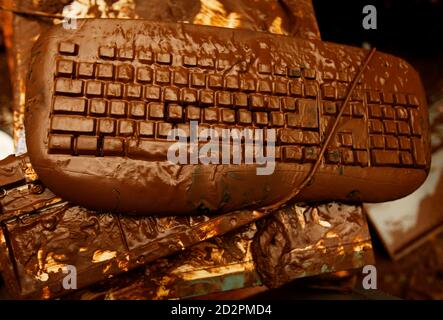 A computer keyboard is covered in mud, inside a house that was damaged when a dam burst, in Jakarta March 28, 2009. The death toll from a burst dam which unleashed a wall of water on the outskirts of the Indonesian capital rose to 77 and authorities were searching for than 100 people still missing, officials said on Saturday. REUTERS/Beawiharta (INDONESIA DISASTER ENVIRONMENT)