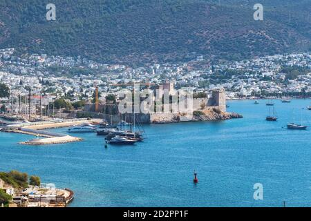 Bodrum Castle and Marina with sailboats and luxury yachts in harbor on the Aegean sea - Stock Photo