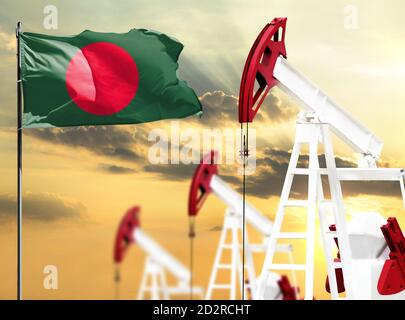 Oil rigs against the backdrop of the colorful sky and a flagpole with the flag of Bangladesh. The concept of oil production, minerals, development of