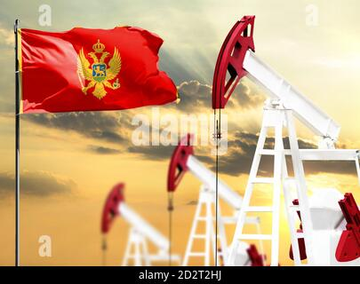 Oil rigs against the backdrop of the colorful sky and a flagpole with the flag of Montenegro. The concept of oil production, minerals, development of
