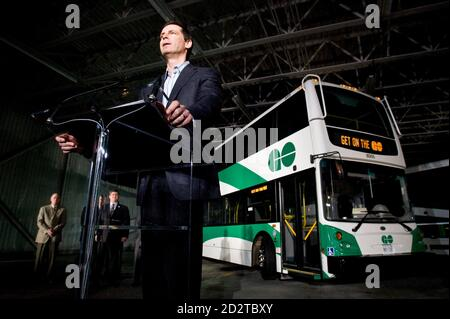 Ontario Premier Dalton McGuinty attends the unveiling of the new Double Decker bus for the GO transit system in Toronto March 20, 2008. The bus is set to improve service by carrying more passengers.     REUTERS/Mark Blinch (CANADA) - Stock Photo