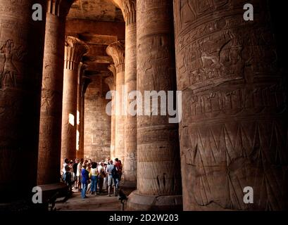 Tourists listen to a tour guide in the Temple of Horus in Edfu, southern Egypt, November 8, 2009. The temple, dedicated to the falcon god Horus, was built in the Ptolemaic period between third and first centuries BC and is one of the best preserved in Egypt.  REUTERS/Goran Tomasevic  (EGYPT SOCIETY TRAVEL) Stock Photo
