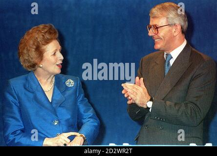 Prime Minister John Major greets Baroness Thatcher on the platform at the Conservative Party Conference in Blackpool's Winter Gardens. - Stock Photo