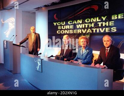 Former Prime Minister  Baroness Thatcher sits next to Prime Minister John Major  at Conservative Central Office in London this morning (Sunday),  where she stepped into the election ring this weekend to deliver a battle-cry to Tory troops fighting the General Election. On either side of Major and Thatcher, is Tory Party Chairman Dr Brian Mawhinney (left) and Robin Hodgson, Chairman of the Conservative National Union. See PA Story ELECTION Thatcher. Photo by Rebecca Naden.  POOL. - Stock Photo