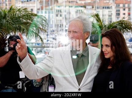 U.S. director Clint Eastwood and cast member Angelina Jolie pose during a photocall for the film 'The Exchange' at the 61st Cannes Film Festival May 20, 2008.    REUTERS/Vincent Kessler  (FRANCE)