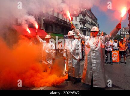 Arcelor Mittal steel workers dressed in protective work suits demonstrate over pension reforms in Marseille June 24, 2010. French unions stage nationwide protests against government pension reforms after France's government, looking to tame a record debt and public deficit, presented its long-awaited proposals for pension reform, featuring an increase in the retirement age to 62 from 60 by 2018. REUTERS/Jean-Paul Pelissier (FRANCE - Tags: CIVIL UNREST EMPLOYMENT BUSINESS POLITICS SOCIETY IMAGES OF THE DAY) - Stock Photo