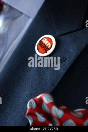 A badge is seen on the lapel of the Prince of Wales as he meets admirers on arrival at the newly rebuilt Royal Shakespeare Theatre at Stratford-upon-Avon, ahead of the RSC's 50th Birthday Gala Performance of Macbeth. - Stock Photo