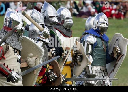 Amateur actors prepare to fight during a re-enactment of the battle at Grunwald, which took place 1410 between Teutonic order knights and Polish and Lithuanian knights, in Grunwald, north Poland July 15, 2006. REUTERS/Katarina Stoltz (POLAND) - Stock Photo