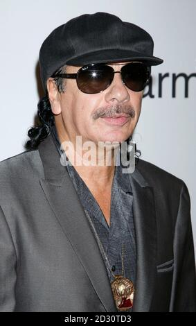Musician Carlos Santana arrives at the Pre-Grammy Gala presented by the Recording Academy and Clive Davis in Beverly Hills, California January 30, 2010. REUTERS/Jason Redmond   (UNITED STATES - Tags: ENTERTAINMENT) - Stock Photo