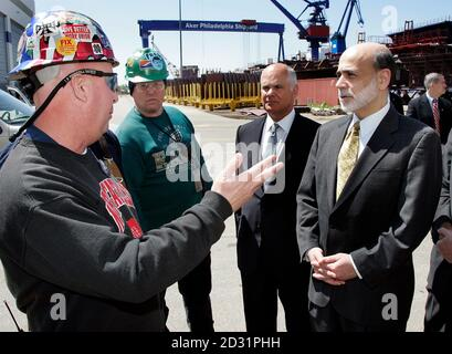 U.S. Federal Reserve Chairman Benjamin Bernanke (R) listens to Gary Gaydosh (L) describe the economic benefits brought by the Aker Philadelphia Shipyard to the regional economy during a tour of the shipyard in Philadelphia, Pennsylvania May 13, 2010. Looking on are Fred Chamerlain, (2nd L) and Charles Pizzi (2nd R), Chairman, federal reserve bank of Philadelphia, Board of Director.  REUTERS/Tom Mihalek (United States - Tags: BUSINESS POLITICS) - Stock Photo