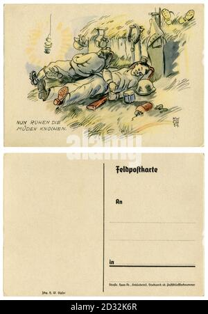 German historical postcard: Now the tired bones are resting. Soldiers are sleeping in the hayloft, military equipment is laid out next to them. 1939 - Stock Photo