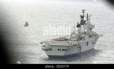 HMS Ark Royal in Mounts Bay, Cornwall. About 300 personnel from three helicopter squadrons flew off the warship to be reunited with loved-ones at RNAS Culdrose, their base at Helston, Cornwall.   *... Among the returning crew were members of 849 A Flight, Airborne Surveillance and Control, which lost seven aircrew when two Sea King helicopters collided in mid-air in the Gulf. Personnel from 814 squadron and 820 squadron also left the carrier. The carrier is en-route back to Portsmouth Naval Base, where she is due to arrive. - Stock Photo