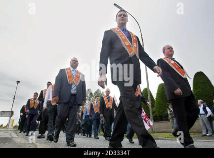 Portadown Orangemen marching through Portadown town prior to their Church service. For the sixth-year running the Orange Order has been blocked from returning through the staunchly Catholic Garvaghy Road following a service at Drumcree Parish Church.  *   on the edge of Portadown. Even though a new peace initiative was put forward which involved the order being allowed to walk down the flashpoint route in return for ending their ban on direct talks with the nationalist residents, it came too late to overturn this year's ruling by the Parades Commission.  - Stock Photo