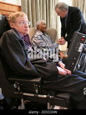Former South African President Nelson Mandela (C) greets former Foreign Minister Pik Botha during a meeting with theoretical physicist professor Stephen Hawking (L) at Mandela's Foundation office in Johannesburg May 15, 2008. Hawking is on a short visit to South Africa. REUTERS/Pool (SOUTH AFRICA) - Stock Photo