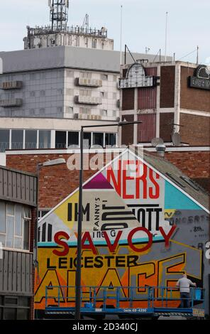 Leicester, Leicestershire, UK. 7th October 2020. An artist works on a street mural 100 days since the UKÕs first local coronavirus pandemic lockdown was announced in the city. Credit Darren Staples/Alamy Live News. Stock Photo