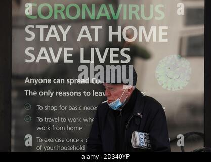 Leicester, Leicestershire, UK. 7th October 2020. A man smokes as he waits for a bus 100 days since the UKÕs first local coronavirus pandemic lockdown was announced in the city. Credit Darren Staples/Alamy Live News. Stock Photo