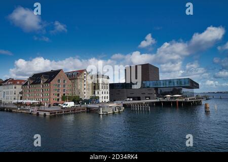 Copenhagen, Europe, Nyhavn promenade in central city with blue cloudy sky