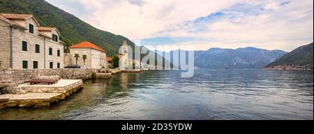 Picturesque Mediterranean village with stone houses against gray mountains, Montenegro, Bay of Kotor ( Adriatic Sea ), Stoliv village. Travel concept, - Stock Photo