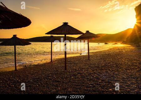 Beautiful sunset on the beach Jaz near Budva in Montenegro (Adriatic Sea), Europe. Travel concept, background.