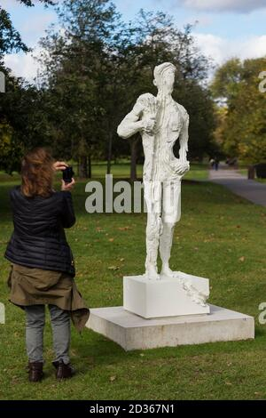London, UK.  7 October 2020. A woman views 'Untitled 1 (Bodybuilders)', 2015, by David Altmejd at Frieze Sculpture, an annual exhibition of outdoor works by international artists in Regent's Park.  The works are on display to the public until 18 October. Credit: Stephen Chung / Alamy Live News - Stock Photo