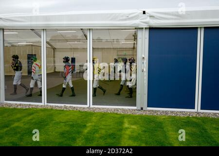 A general view as jockeys leave the weighing room at Ludlow Racecourse.
