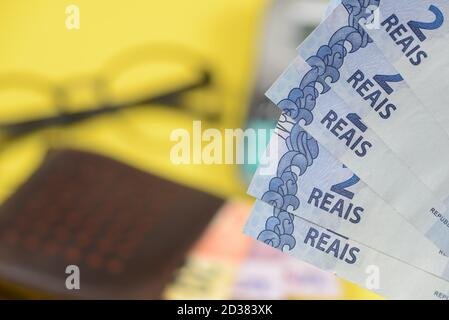 money coming out of wallet with blurred background.
