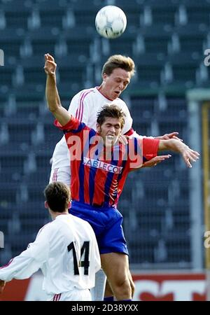 Feliciano Magro (C) of FC Basel and Egli Ulfstein (C above) of Norway's SK Brann Bergen jump for the ball as Sergei Terehhov (L) looks on during the UEFA Cup first round first leg match FC Basel vs. SK Brann Bergen in Zurich, Switzerland, September 12, 2000.  SIB/HM/JRE - Stock Photo