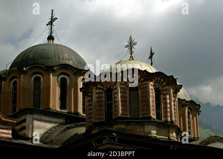 A view of the dome of main church at the Rila Monastery, some 125 km south-west from Sofia on June 18, 2003. Rila Monastery, the biggest Bulgarian monastery was founded in the l0th century by the Bulgarian monk St. John of Rila and was rebuilt in the l3th - l4th century. In the l5th century, when Bulgaria fell to the Ottoman Turks, the monastery was abandoned for a short time but in the second half of the same century it was restored to a new life. Its thorough renovation began in the early l9th century. REUTERS/Oleg Popov  OP/AS - Stock Photo