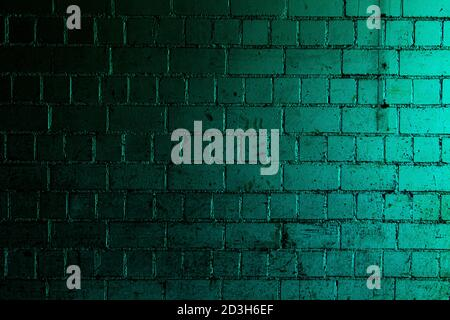 Petrol brick wall background with shades of light and dark teal